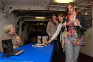 Lisa Tracy aboard the Olympia, Adm. Dewey's flagship, in Philadelphia.
